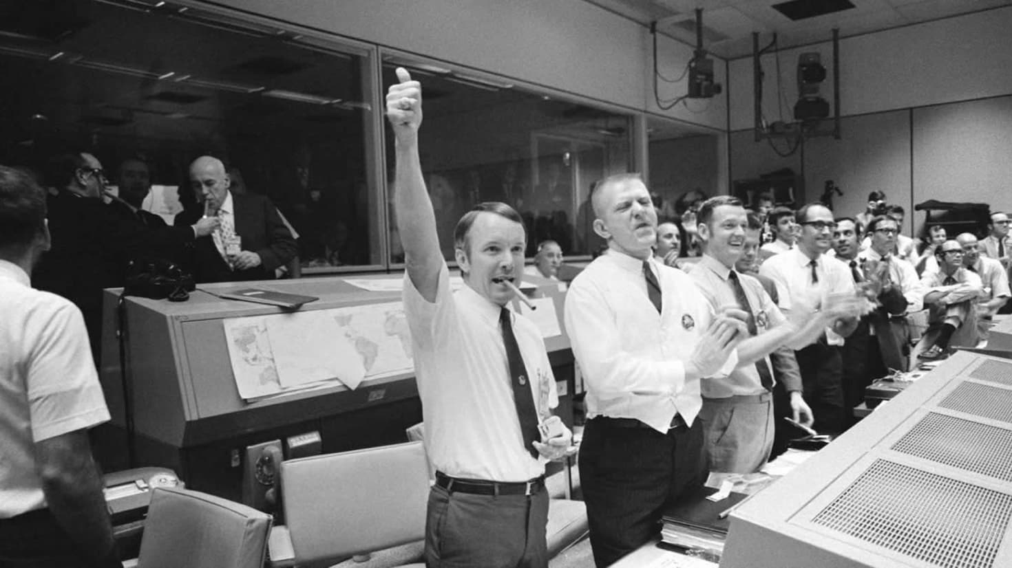 Historic photo of NASA ground control memebers celebrating mission success